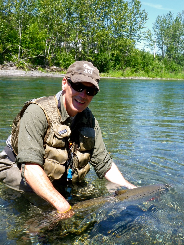 Atlantic Salmon Federation President Bill Taylor puts a nice one back on the Petite Cascapedia. Nice fish Bill !